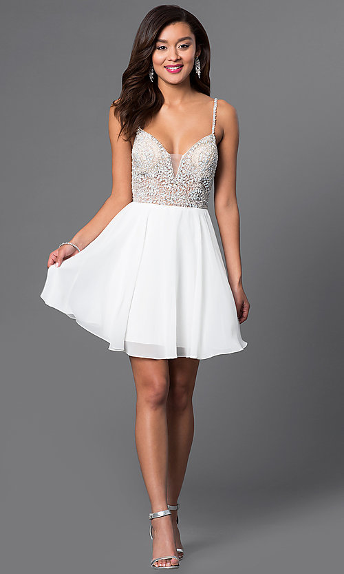 Image of short illusion jeweled-bodice homecoming dress. Style: JO-JVN-JVN47310 Detail Image 1