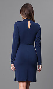 Image of short navy blue jersey party dress with long sleeves. Style: BC-YDM64K84 Back Image