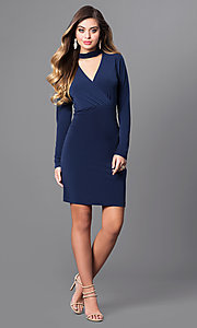 Image of short navy blue jersey party dress with long sleeves. Style: BC-YDM64K84 Detail Image 1
