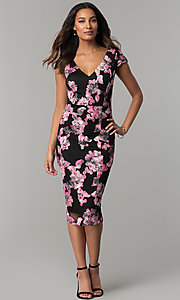 Image of short black wedding-guest dress with floral applique. Style: JX-1ZYO302Q Front Image