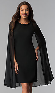 Image of wedding-guest short black dress with attached cape. Style: IT-111407 Front Image