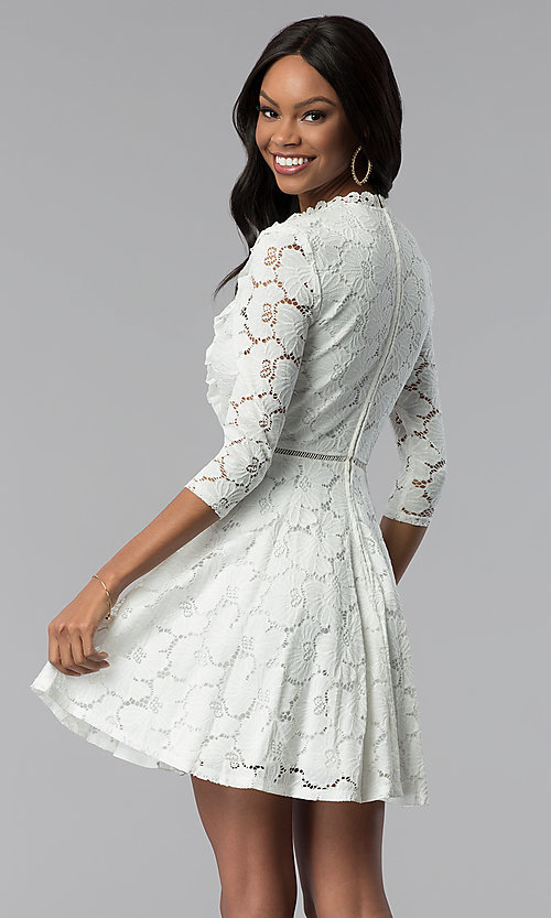Image of white lace 3/4-sleeve high-neck graduation dress. Style: CT-3623KK8BT1 Back Image