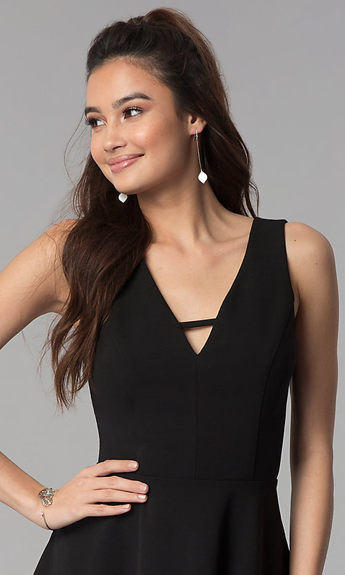 Image of short black v-neck cocktail party dress. Style: CT-7711QQ2AT3 Detail Image 1