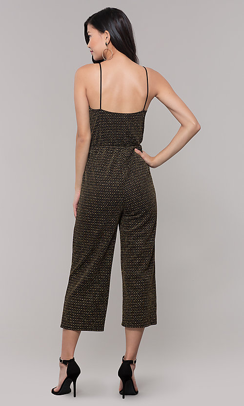 Image of gold v-neck holiday jumpsuit. Style: RO-R68726 Back Image