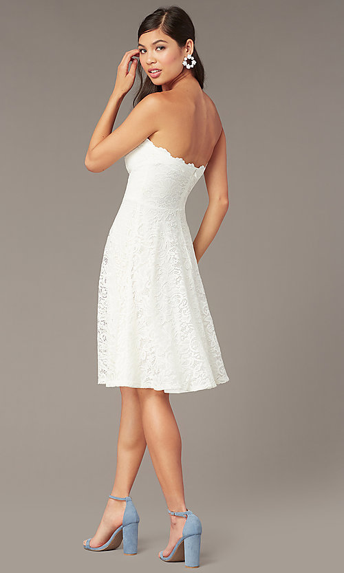 Image of strapless ivory lace short a-line party dress. Style: JU-10394D Back Image