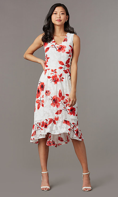 Image of high-low red-print short white party dress. Style: ECI-720237-75850 Front Image