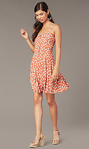 Image of coral/ivory short casual floral-print party dress. Style: EM-HHS-4085-681 Front Image