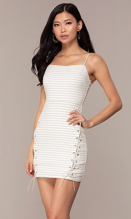 Image of short black-striped white graduation party dress. Style: AC-DH24533E Front Image