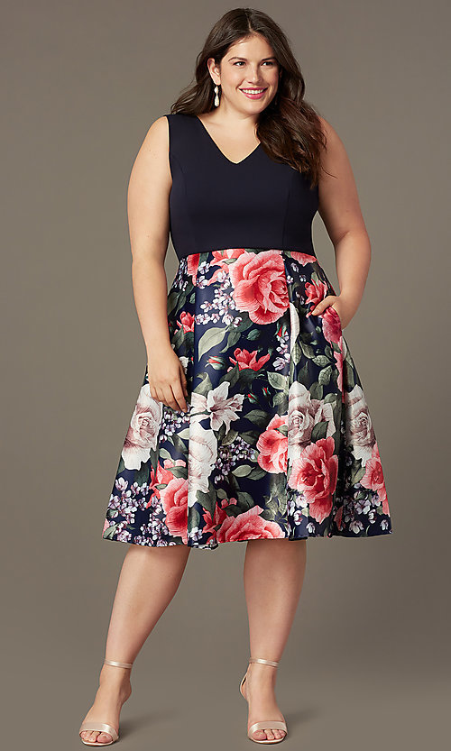 Image of plus-size short v-neck print-skirt party dress. Style: MCR-2623 Front Image