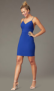 Image of indigo blue short tight party dress with back bow. Style: CT-7253BX9T3 Front Image