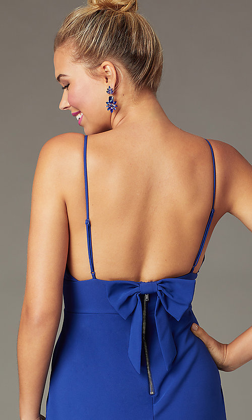 Image of indigo blue short tight party dress with back bow. Style: CT-7253BX9T3 Detail Image 1