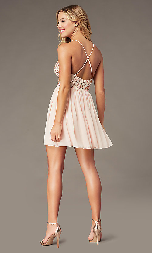 Image of short sequin-bodice homecoming dress by PromGirl. Style: MCR-PL-2600 Back Image