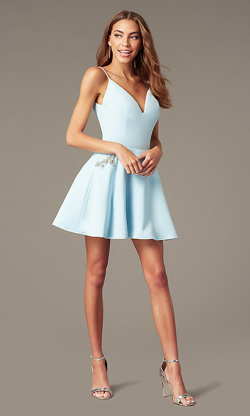 Image of short satin homecoming dress with accented pockets. Style: NC-259 Front Image