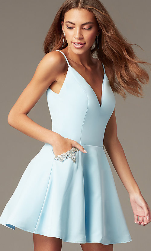 Image of short satin homecoming dress with accented pockets. Style: NC-259 Detail Image 1