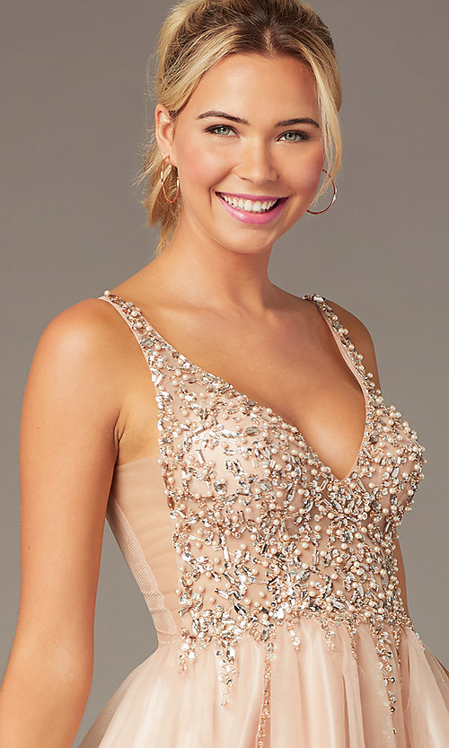 Image of beaded short homecoming tulle dress by PromGirl. Style: NA-PL-G694 Detail Image 1