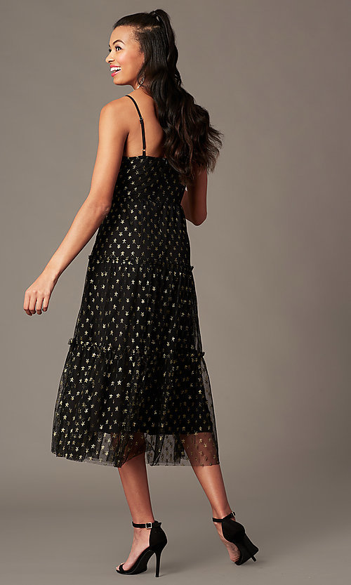 Image of tea-length gold-print black holiday party dress. Style: IF-101995DQ Back Image