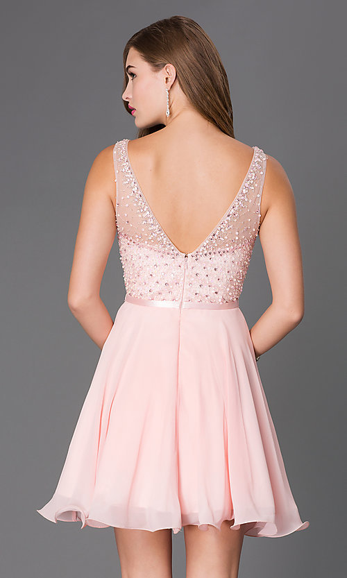 Image of short sleeveless sequin embellished illusion sweetheart a-line dress Style: NA-6163 Back Image