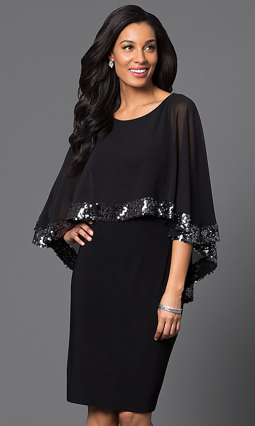 Image of knee-length black party dress with attached cape. Style: SD-s275090 Front Image