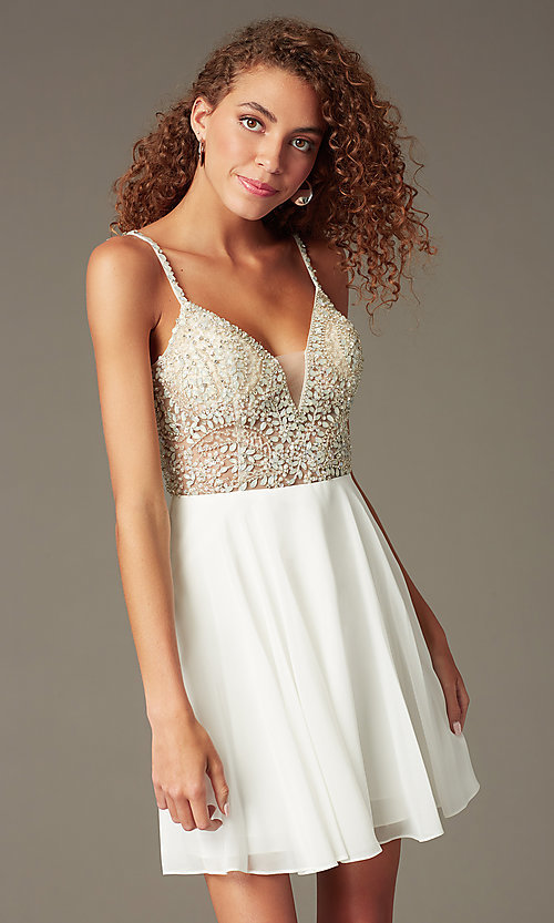 Image of short illusion jeweled-bodice homecoming dress. Style: JO-JVN-JVN47310 Front Image