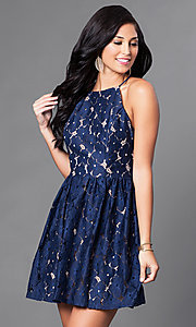 Image of short navy and tan open-back lace homecoming dress. Style: CT-6633ST2C Front Image
