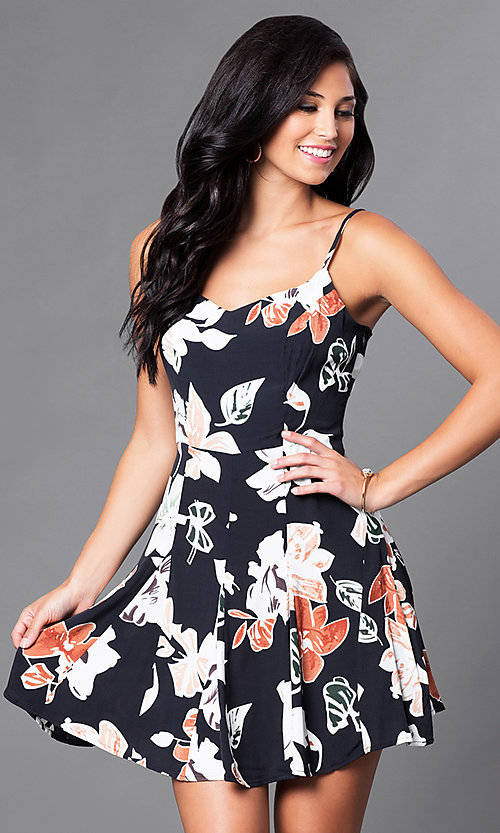 Image of black floral-print short spaghetti-strap casual dress. Style: AC-DE22159R Front Image