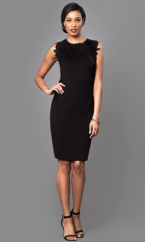 Image of knee-length black party dress with lace applique. Style: IT-118785 Detail Image 1