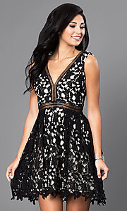 Image of short sleeveless v-neck black lace homecoming dress. Style: INA-IDA70930 Front Image