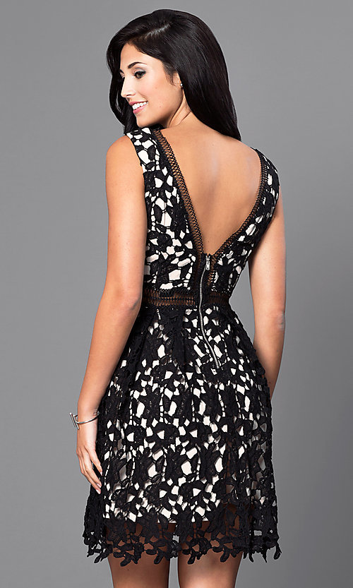 Image of short sleeveless v-neck black lace homecoming dress. Style: INA-IDA70930 Back Image