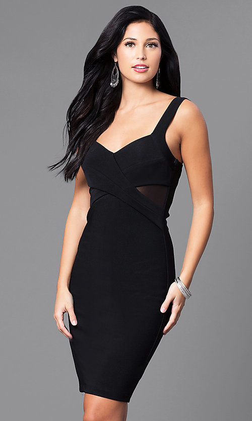 Image of black knee-length party dress with sheer sides. Style: EM-ESI-1027-001 Front Image