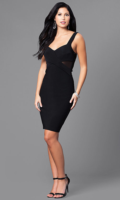 Image of black knee-length party dress with sheer sides. Style: EM-ESI-1027-001 Detail Image 1