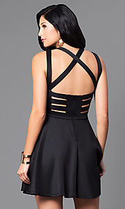 Image of black short party dress with bodice cut-outs. Style: EM-EVN-1003-001 Back Image