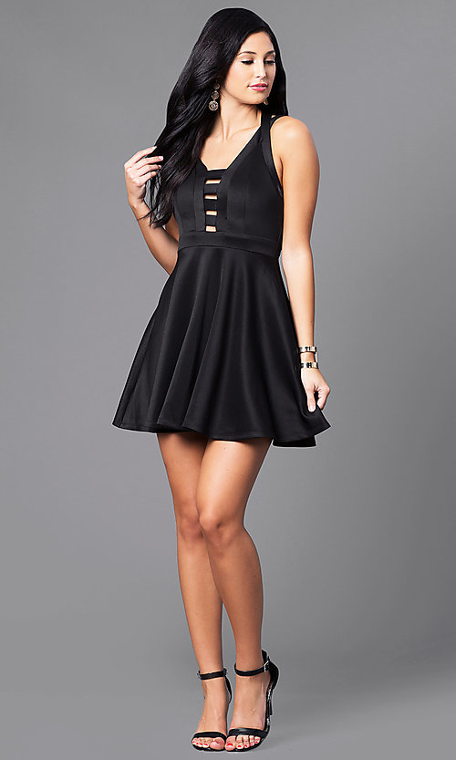 Image of black short party dress with bodice cut-outs. Style: EM-EVN-1003-001 Detail Image 1