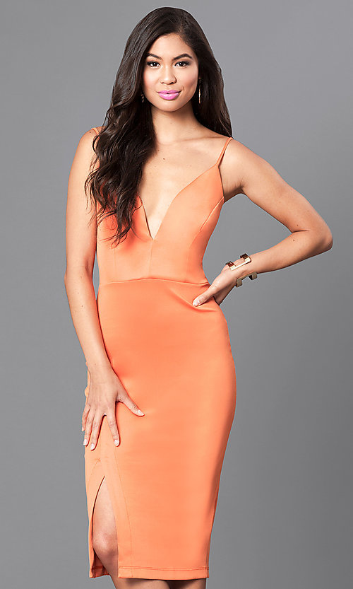 Image of deep v-neck spaghetti-strap knee-length dress. Style: MD-D14967OA Front Image