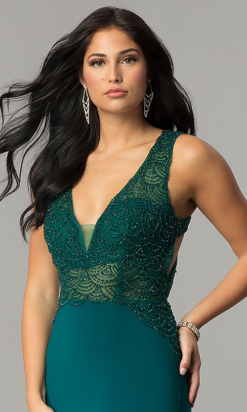 Image of navy blue beaded deep v-neck floor-length prom dress. Style: DJ-1729 Detail Image 1