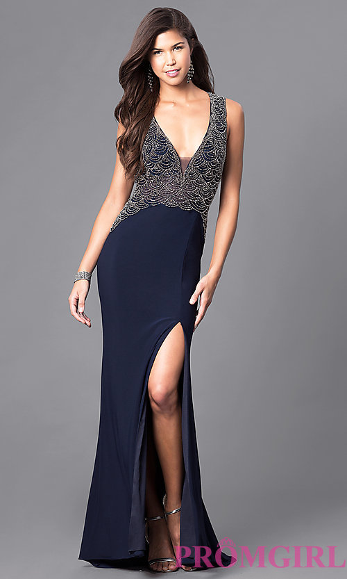Image of navy blue beaded deep v-neck floor-length prom dress. Style: DJ-1729 Front Image
