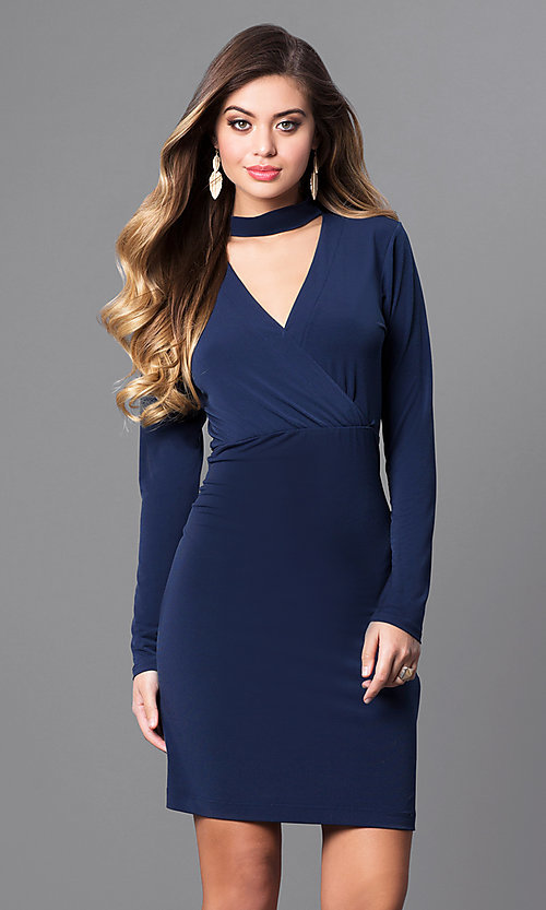 Image of short navy blue jersey party dress with long sleeves. Style: BC-YDM64K84 Front Image