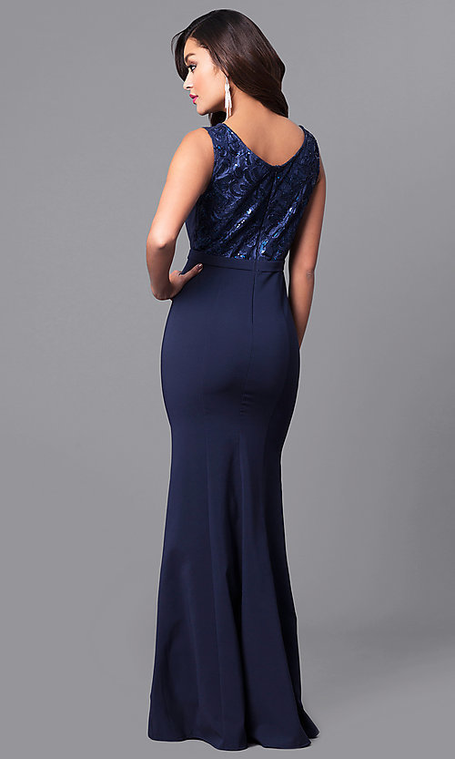 Image of long navy prom dress with lace and sequin bodice. Style: MCR-2123 Back Image