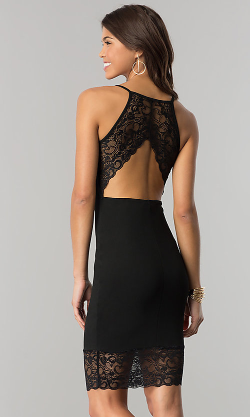 Image of knee-length black party dress with sheer lace. Style: EM-FHH-1606-001 Back Image