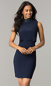 Image of short navy blue popover party dress with beading. Style: JU-MA-263606 Front Image