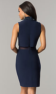 Image of short navy blue popover party dress with beading. Style: JU-MA-263606 Back Image
