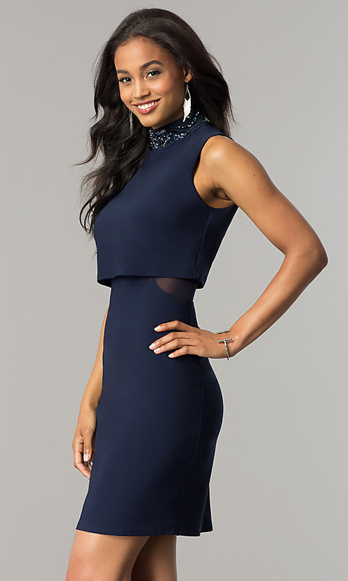 Image of short navy blue popover party dress with beading. Style: JU-MA-263606 Detail Image 1