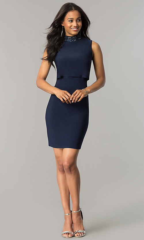 Image of short navy blue popover party dress with beading. Style: JU-MA-263606 Detail Image 2