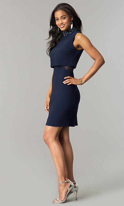 Image of short navy blue popover party dress with beading. Style: JU-MA-263606 Detail Image 3