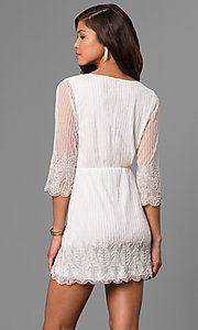 Image of beaded short lace party dress with sheer sleeves. Style: VE-658-213443 Back Image