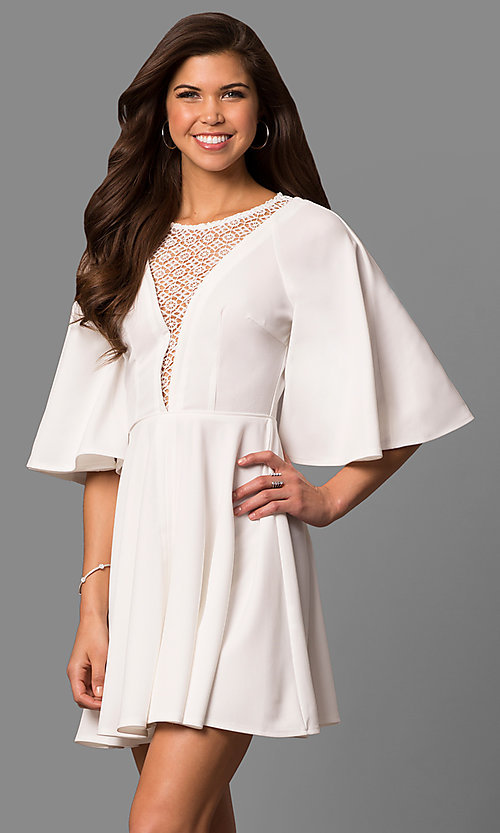 Image of short a-line bell-sleeve party dress with lace inset. Style: LP-24581 Detail Image 1
