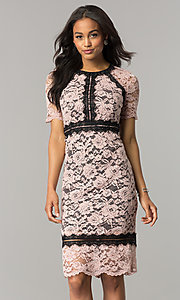 Image of blossom pink lace wedding-guest dress with black trim. Style: JX-1ZWD268Q Front Image