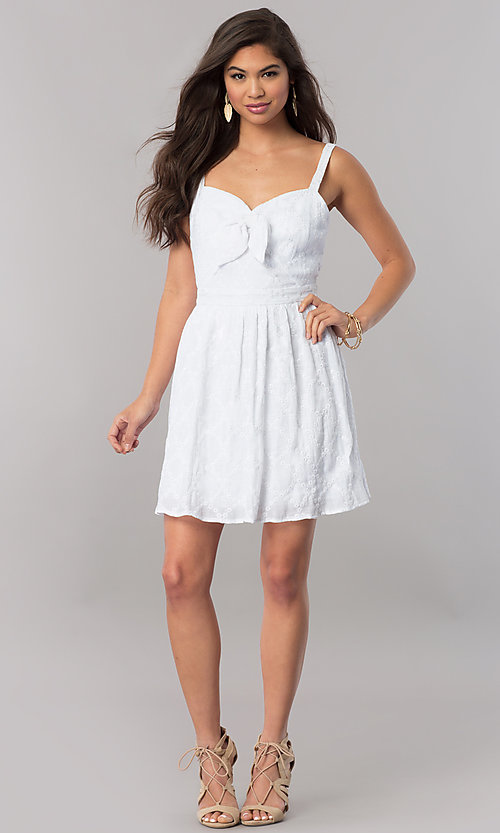 Image of short white sleeveless party dress with bow. Style: EM-FBH-2945-100 Detail Image 1