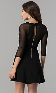 Image of short black a-line homecoming dress with sleeves.  Style: EM-FLQ-1027-001 Back Image