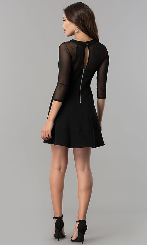 Image of short black a-line homecoming dress with sleeves.  Style: EM-FLQ-1027-001 Detail Image 2