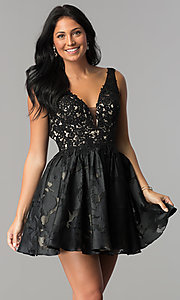 Image of open-back black v-neck short homecoming party dress. Style: TI-GL-1725H4802 Front Image